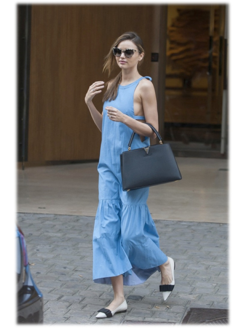 Get the look Miranda Kerr n Louis Vuitton Resort 2014 blue drop waist dress styled with a Louis Bag Miu Miu flats, and Stella McCartney Sunnies