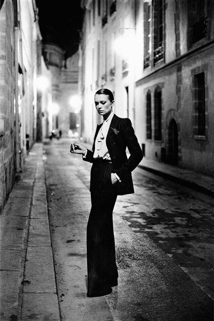Yves Saint-Laurent, Vogue France, Rue Aubriot, Paris, 1975. © Helmut Newton